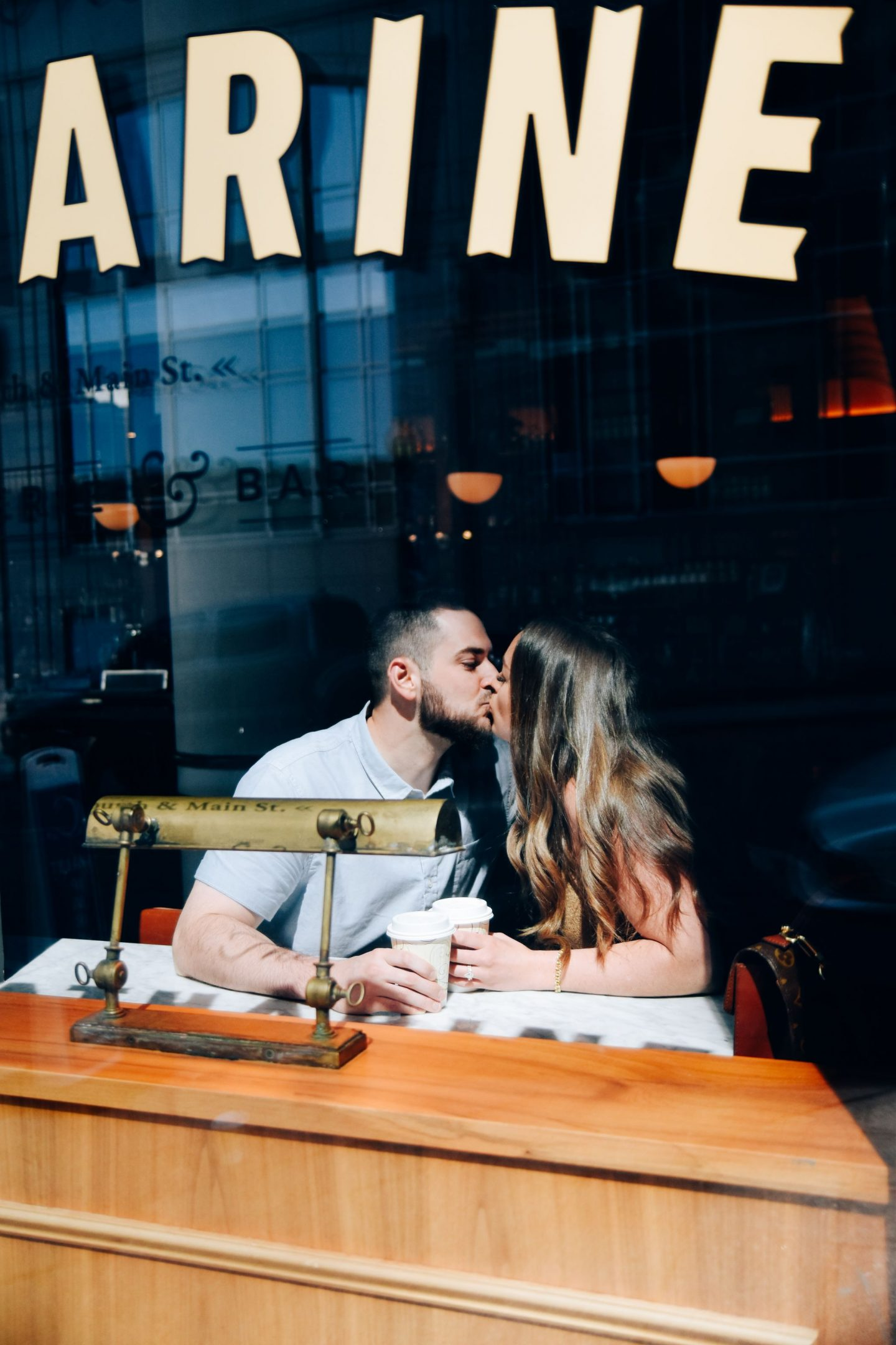 Couple Kissing in Coffee Shop